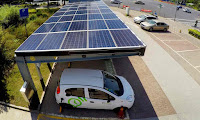 An electric car charged at a solar power carport in Shanghai, China. (Photograph Credit: Imaginechina/REX/Shutterstock) Click to Enlarge.