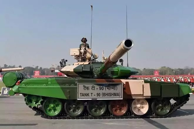 Indian army officers stand on vehicles displaying missiles during the Republic Day parade in New Delhi, India, January 26,