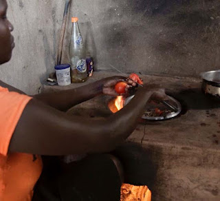Cooking dinner in French Cote d'Ivoire Africa.