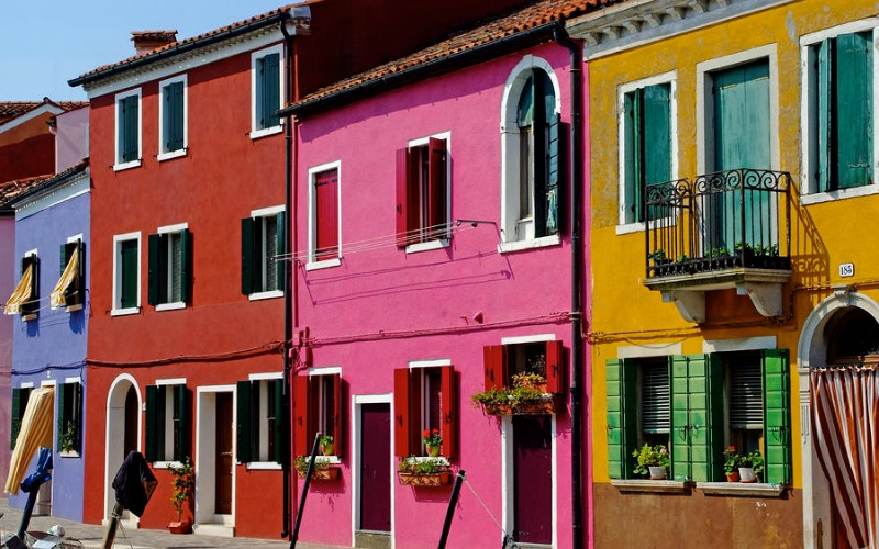 burano italy pink house colorful travel impressa poise review