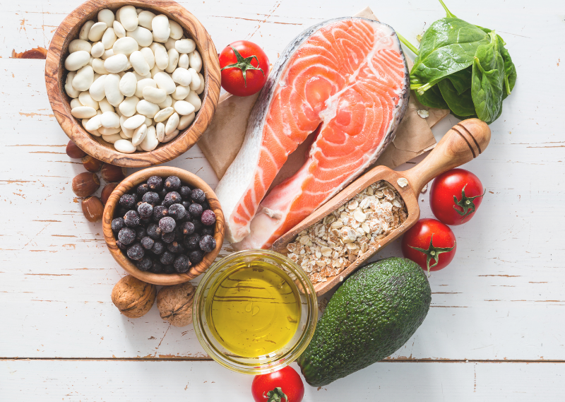 Healthy foods, including salmon, nuts, avocado and tomatoes in a post about five ways to look after your wellbeing during lockdown.