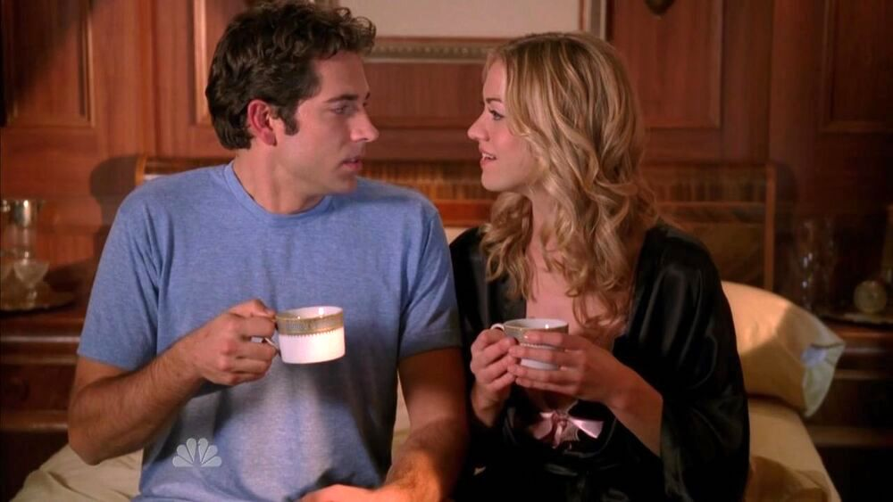 Zachary Levi as Chuck facing Yvonne Strahovski as Sarah, holding a demi-tasse