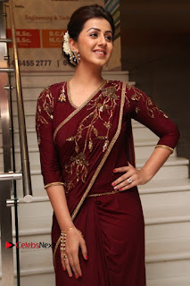 South Indian Actress Nikki Galrani Stills in Red Designer Saree at Maragadha Naanayam Tamil Movie Audio Launch  0012.jpg