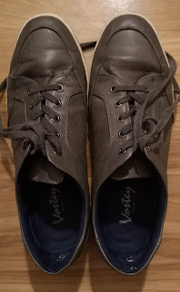A used pair of Vostey Leather Men's Fashion Sneakers in dark grey