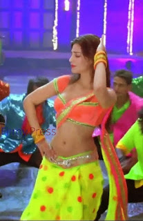 shruti hassan hot in yellow pavada orange blouse photos from yevadu movie HQ Photo EQ4 - Shruti hassan seducing hot Photos In Yevadu Dimple pimple song:Boobs Cleavage and Sexy Navel Compilation