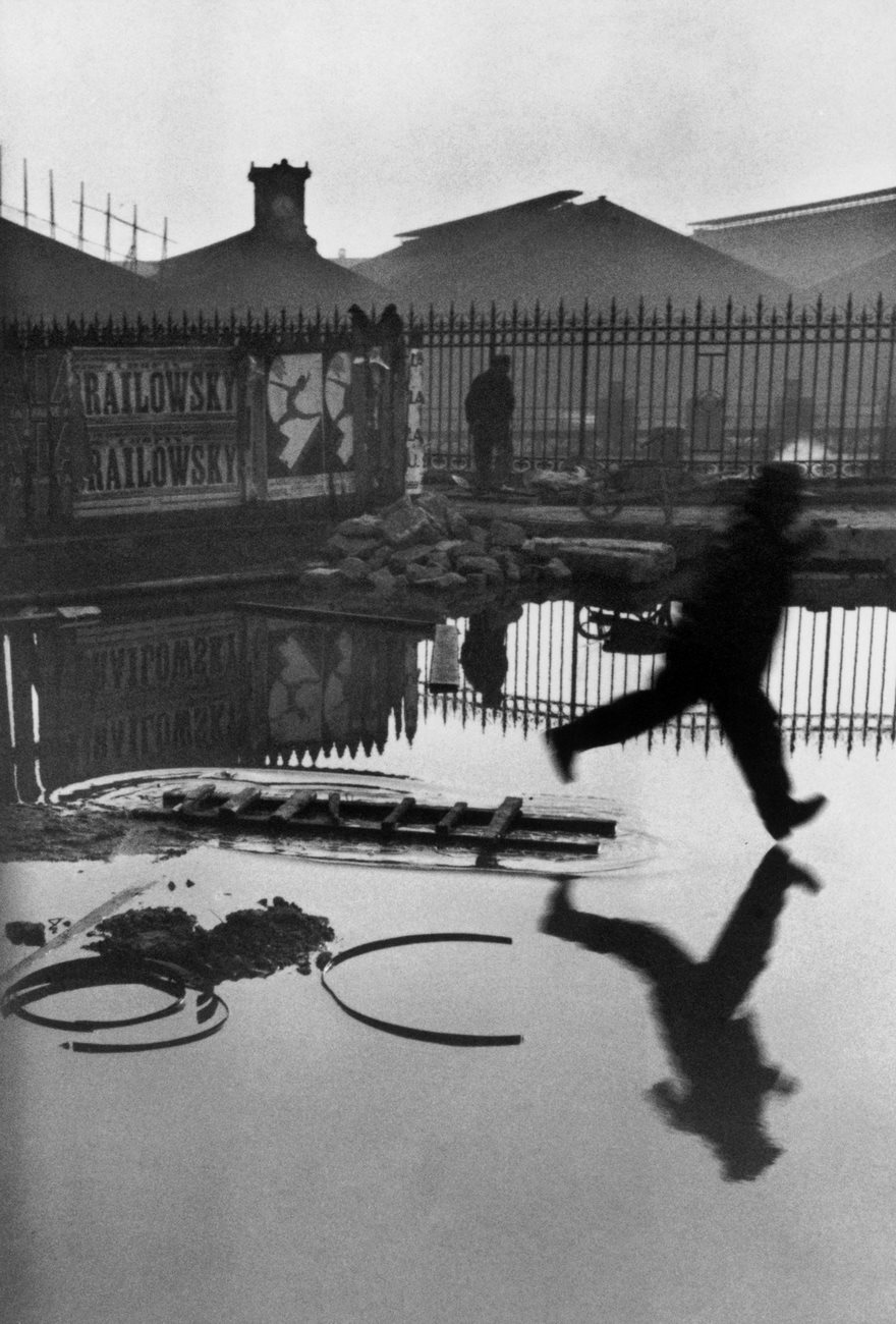 #77 Behind The Gare Saint-Lazare, Henri Cartier-Bresson, 1932 - Top 100 Of The Most Influential Photos Of All Time