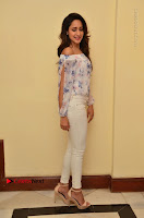 Actress Pragya Jaiswal Latest Pos in White Denim Jeans at Nakshatram Movie Teaser Launch  0057.JPG