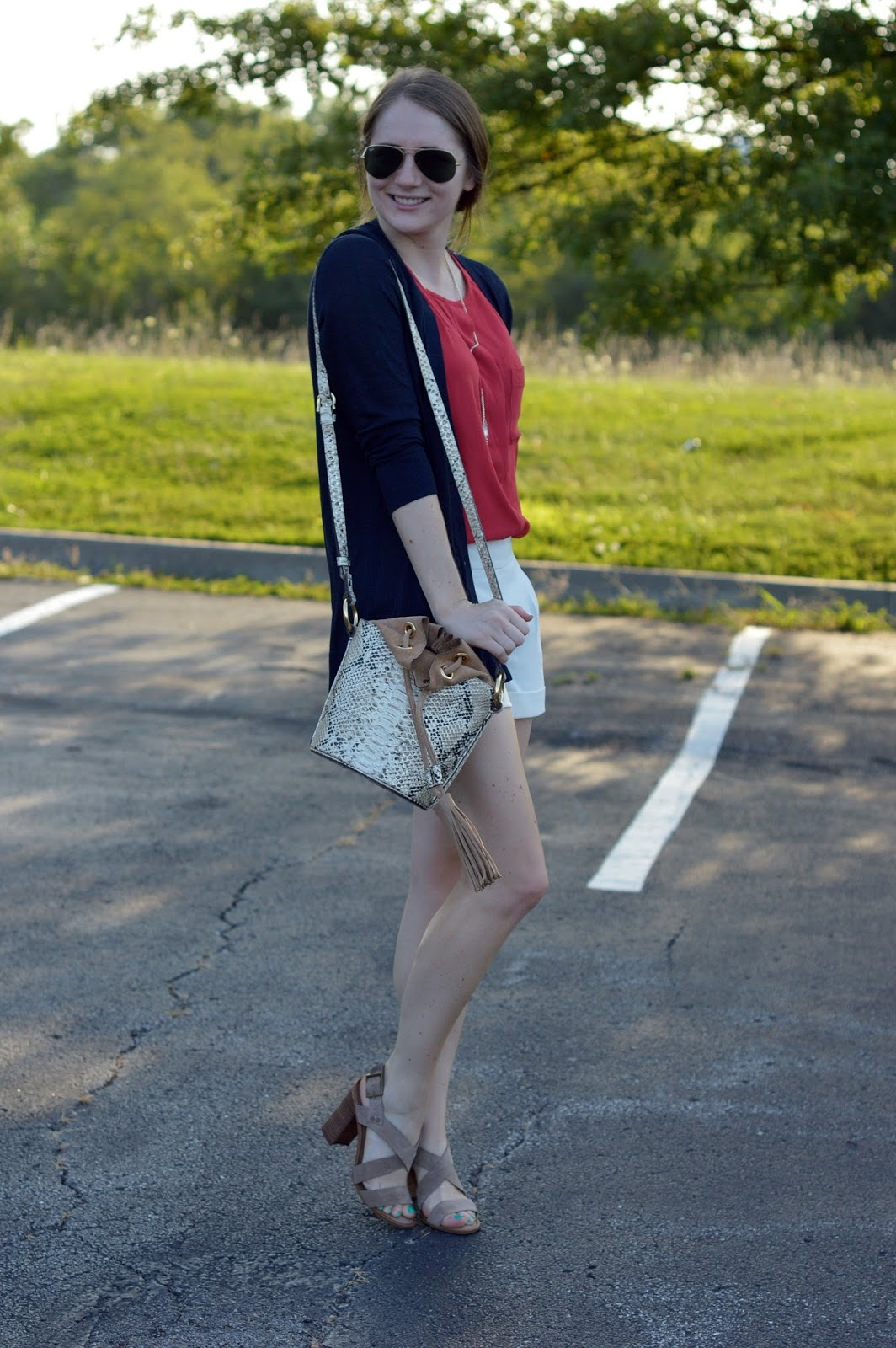 patriotic outfits to wear for labor day | shorts with heeled sandals | how to wear shorts with heels | tassel bucket bag | red white and blue looks |