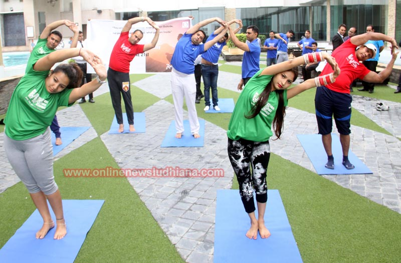 The staff and guests doing Yoga during International Yoga Day Celebrations at MBD