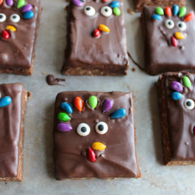 turkey decorated rice krispie treats with sunflower seed tail feathers, beak and gobbler