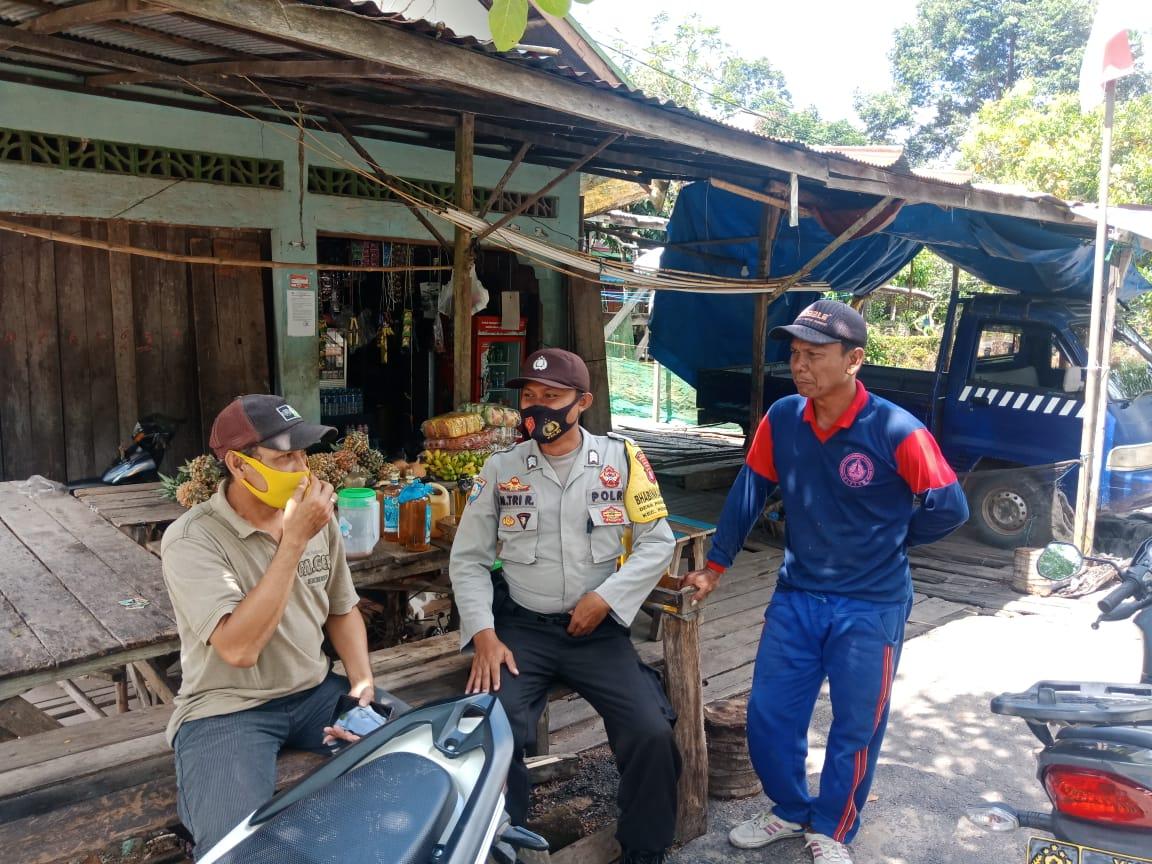 Cegah Penularan Virus Covid-19, Bhabinkamtibmas Desa Pangkoh Hilir Imbau Warga