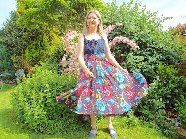 Pretty floaty dress from JD Williams website modelled in a green and leafy garden