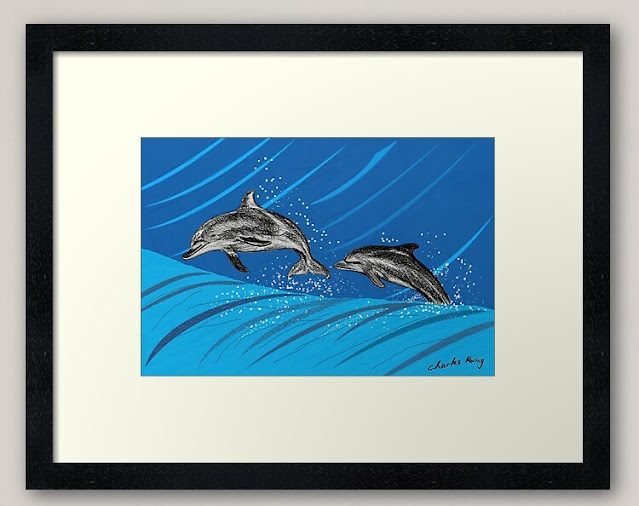 a couple of dolphins jumping at the blue sea