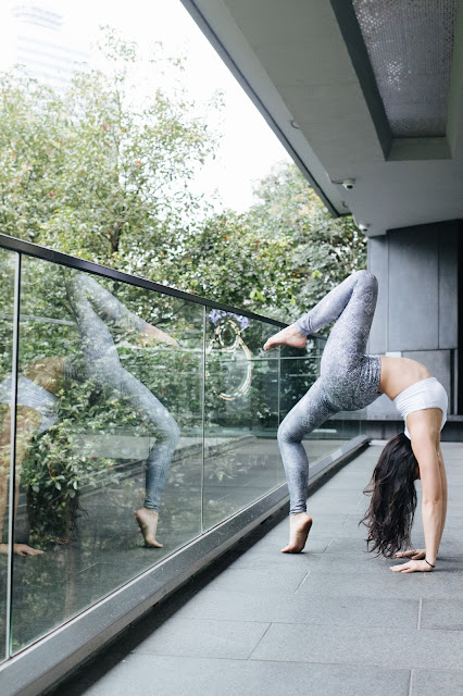 Wearing She Collective HK while doing my yoga backbend wheel pose in Hong Kong