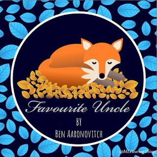A stylised drawing of a fox from Pixabay, curled on a pile of leaves. Text below reads 'Merry Christmas'. The border is blue.