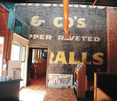 Old Levi Strauss's painting sign discovered behind plaster at El Charro restaurant in Arizona, Prescott