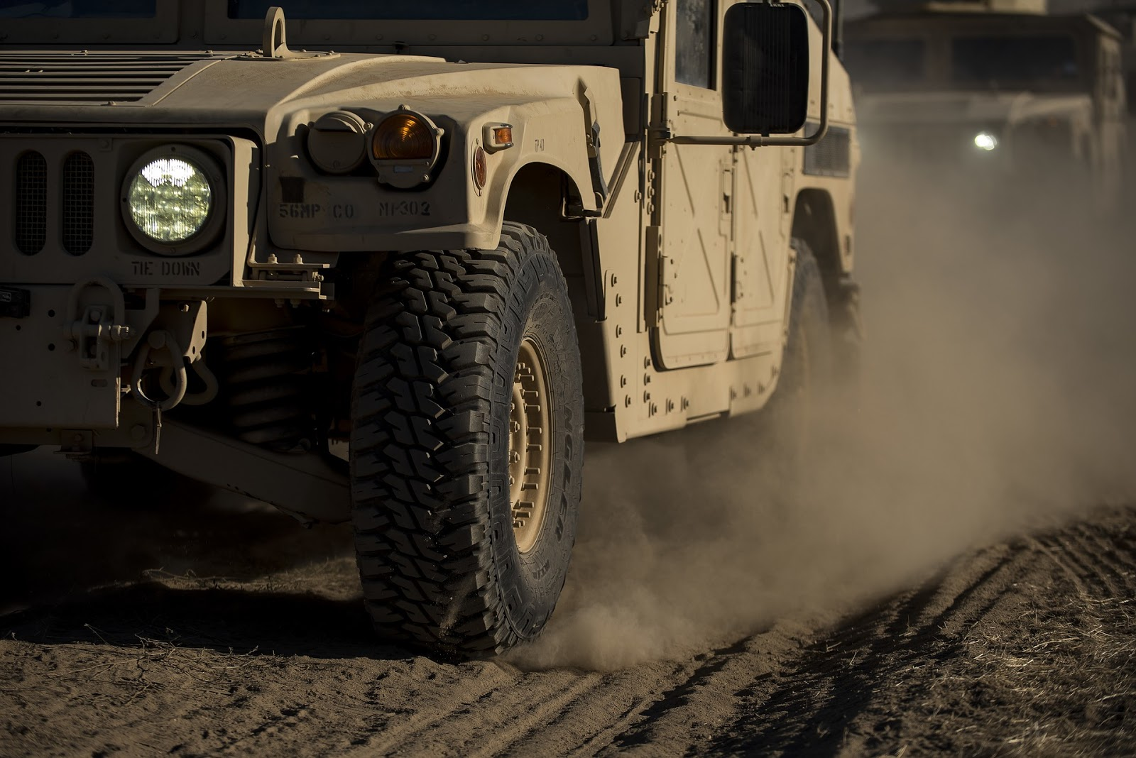a military humvee drives down a dirty road to illustrate a blog post about the mini-series generation kill
