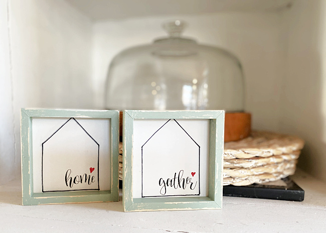 Home and gather signs with a cloche