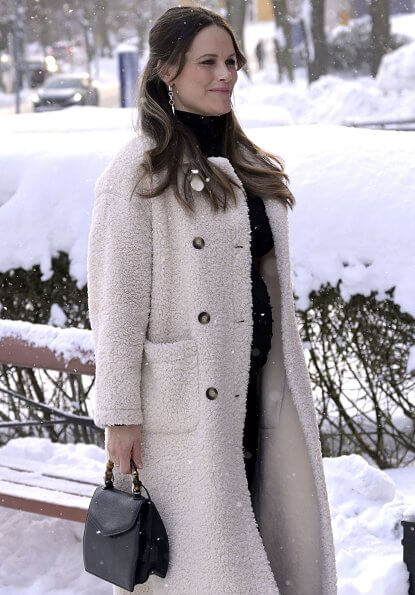 Pregnant Princess Sofia wore Chaos Queen earrings from Maria Nilsdotter Stockholm. 2nd day white coat faux fur. bamboo handle handbag