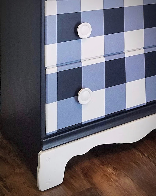 drawer front of a dresser in navy and blue chalk paint in a buffalo check or gingham print, base is finished off with white scallop trim