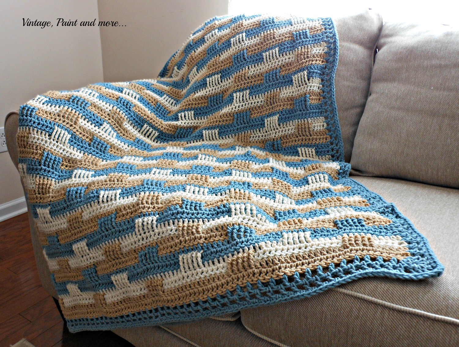 a crochet afghan done in a basket weave pattern for a coastal decor