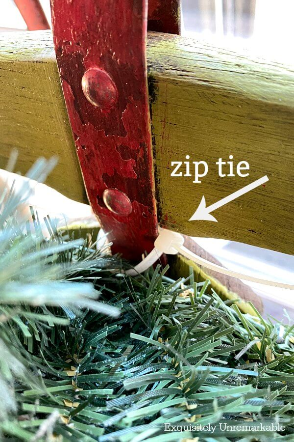Using A Zip Tie To Attach Wreath To Sled