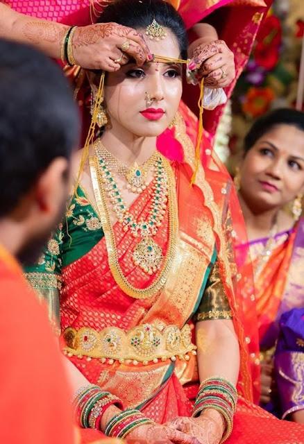 Bride in Kasu Mala Mesh Necklace