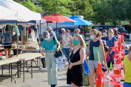 Masked shoppers lined up at farmers market