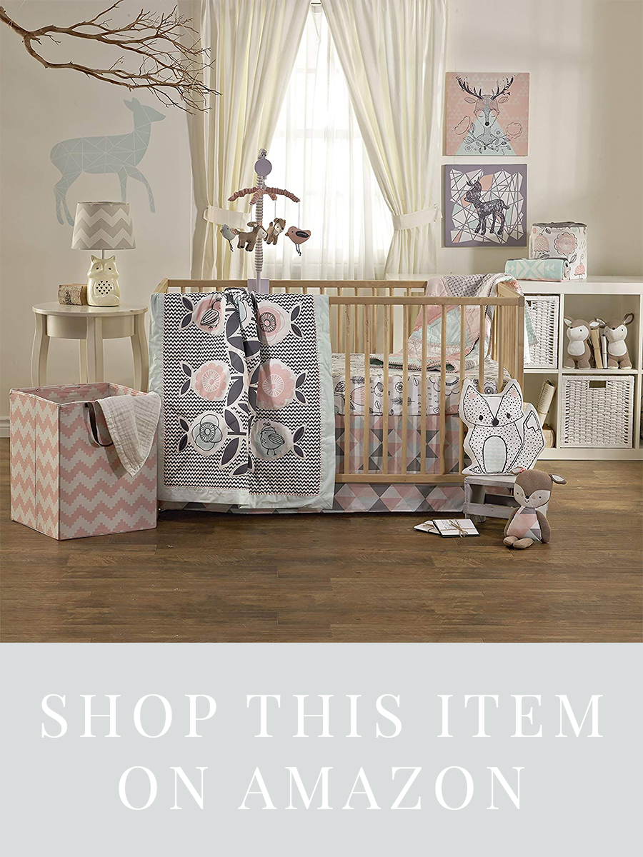 Bohemian themed baby nursery with deer, birds, and geometric shapes. Includes crib bedding ensemble, wall decor and art prints, infant mobile, blankets, toys, and matching decor. In pink, gray, blue, color palette perfect for a baby girl's nursery!