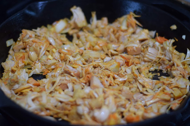 The seasoned jackfruit in a pan, browning.
