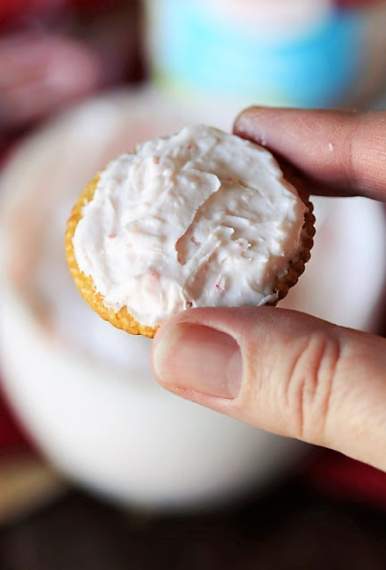 Spreading Ritz Crackers with Peppermint Filling Image