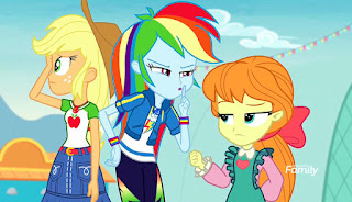 Applejack looks left out of shot as Rainbow Dash shushes Megan Williams