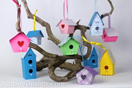 Display A Birdhouse Village Hanging From A Gnarled Piece Of Driftwood