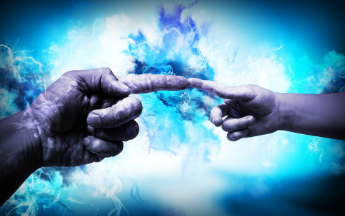 Dedo de adulto tocando o dedo de uma criança, imitando o afresco de Michelangelo, da criação de Adão. #PraCegoVer
