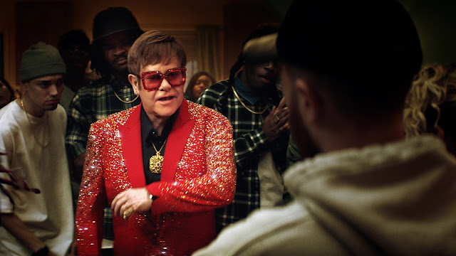 Captain Fantastic Elton John 'Hits Up' The Rap Scene In New Snickers Ad