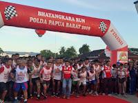 Ribuan Peserta Ramaikan Polda Papua Barat Dalam Acara Fun Run HUT Bhayangkara Ke 73