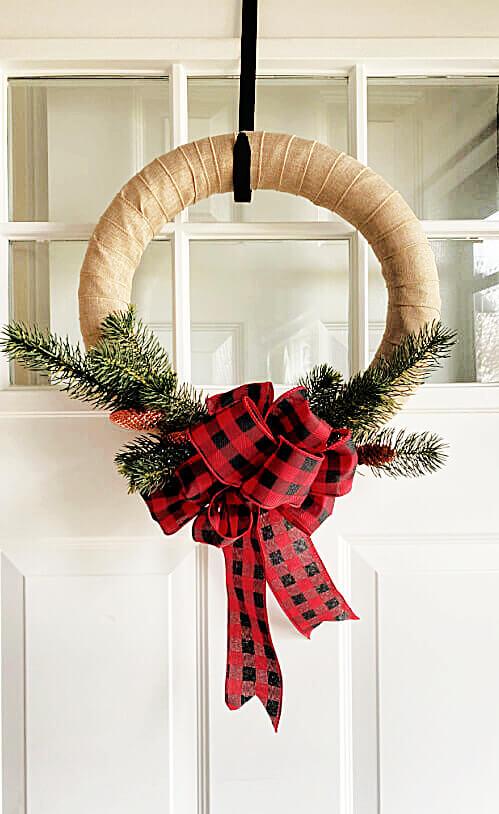 Christmas wreath hanging on front door