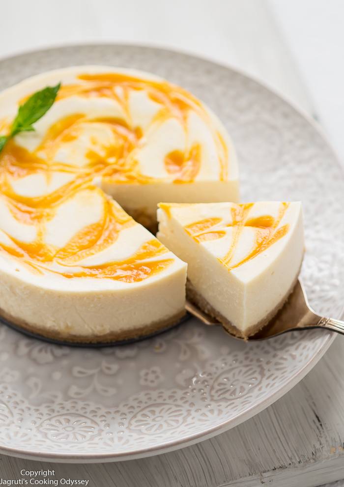 Insuant pot cheesecake sliced served with a fresh mint leaves