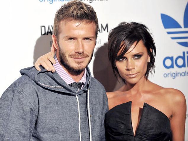 David Beckham With His Wife Victoria Beckham 2013