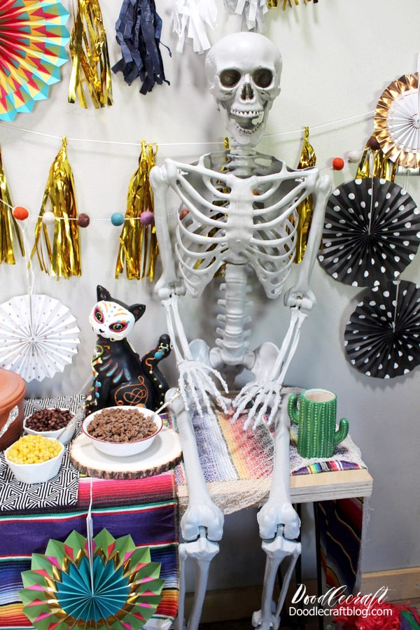 Use a posable skeleton for a fiesta dia de muertos or day of the dead party.