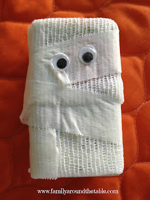 juice box wrapped in gauze to look like mummy