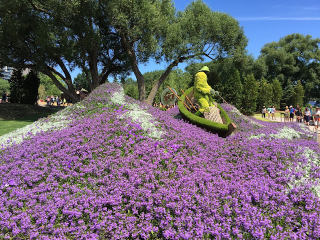 Topiary trapper canoes on a sea of flowers at Mosaic, Hull, Quebec