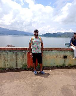 Enjoying the sun on top of Banasura Sagar Dam