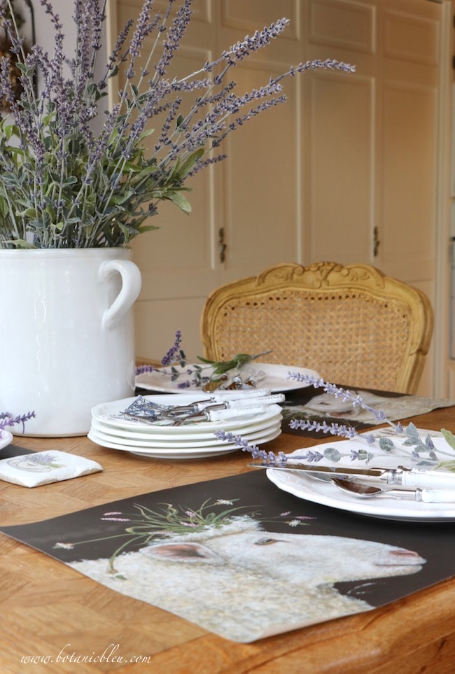 Whimsical Summer Lavender Tablesetting has paper placemats with sheep with wildflower crowns