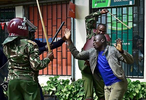 kenya police beating up civilians who are protesting for election reforms on May 16th 2016