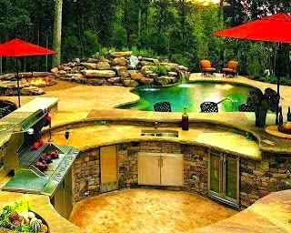 Backyard paradise with outdoor kitchen and swimming pool.
