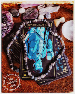 Knight of Goblets card, from the Supernatural tarot, in the reversed position.