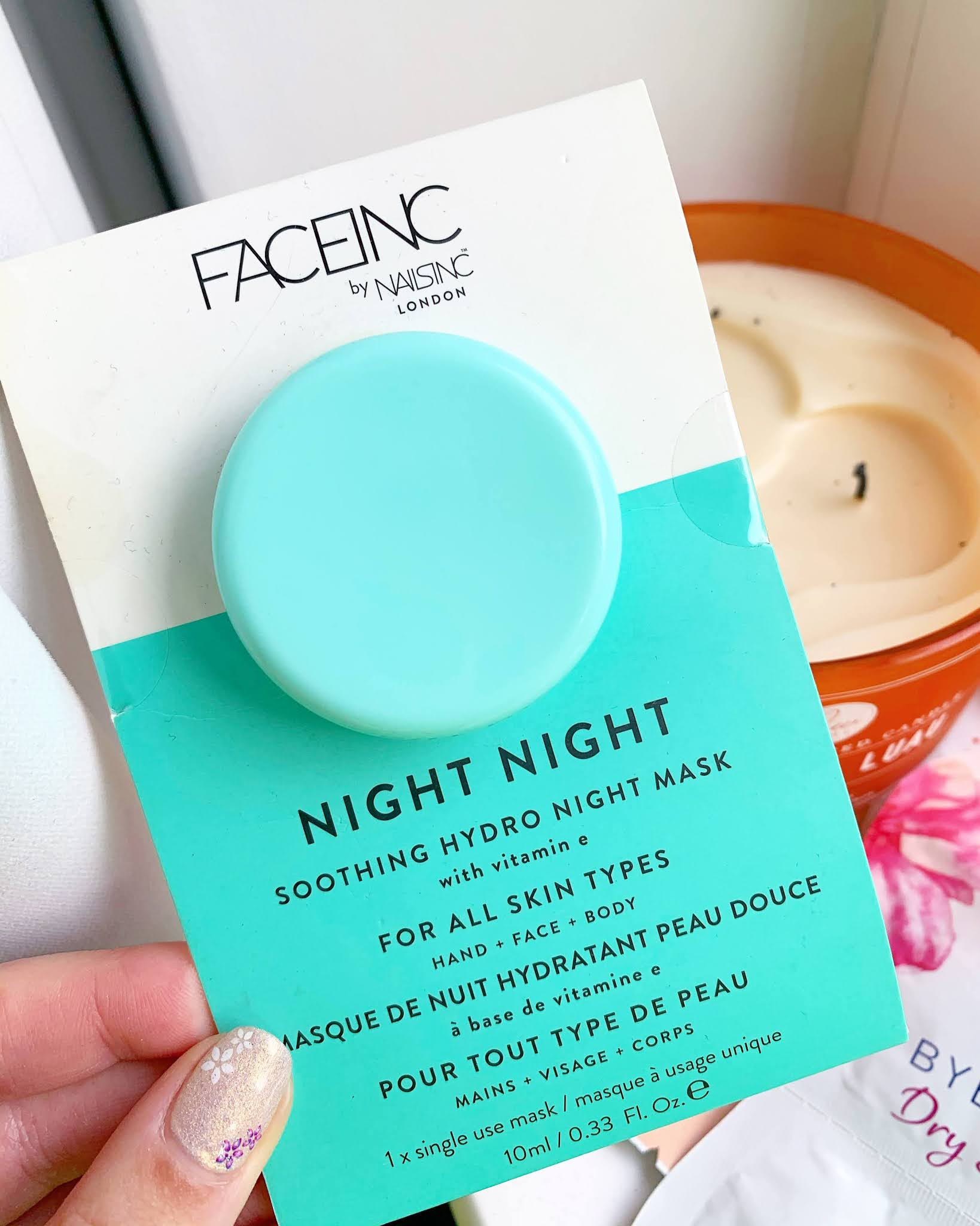 Nails Inc Night Night Soothing Hydro Night Mask held in a hand