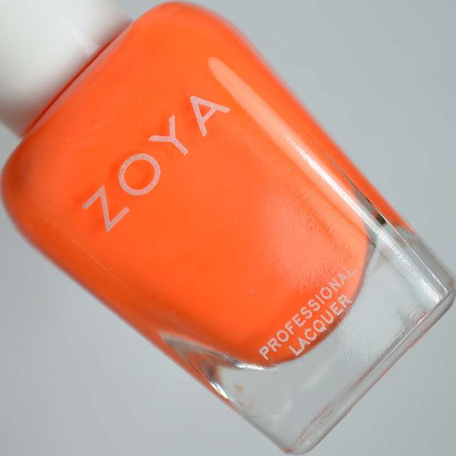 matte neon orange nail polish in a bottle