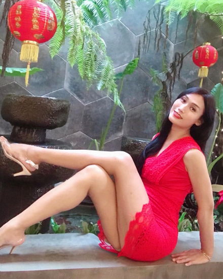 transgender in red dress...